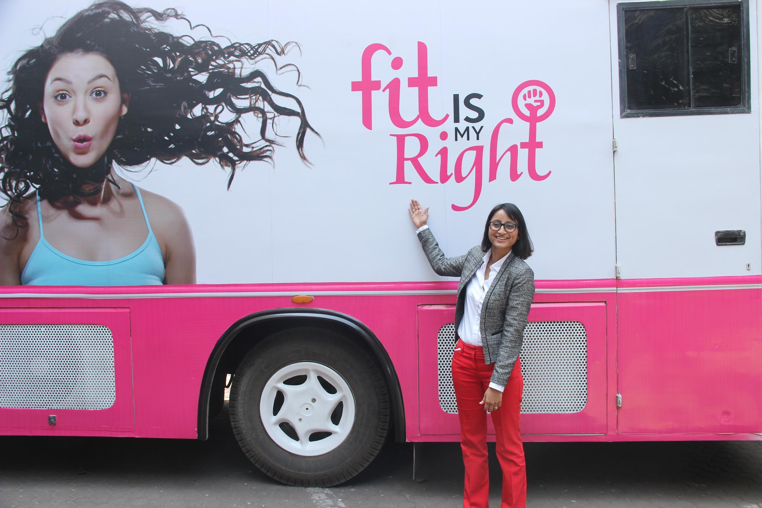 Richa Kar posing with the Fit Van