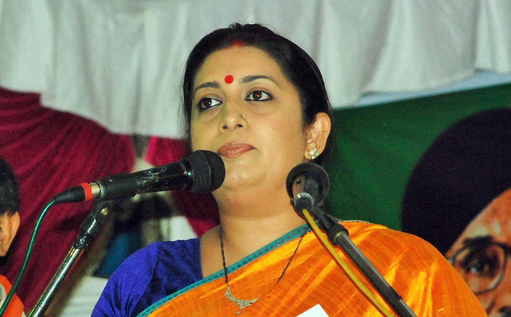 Actress-turned-BJP Parliamentarian Smriti Irani addresses during a Shiromani Akali Dal rally at Rajouri Garden in New Delhi on Nov.27, 2013. Bharatiya Janata Party (BJP) and the Shiromani Akali Dal have finally agreed to a seat-sharing formula for the upcoming Delhi assembly elections slated for 4th December. (Photo: IANS)