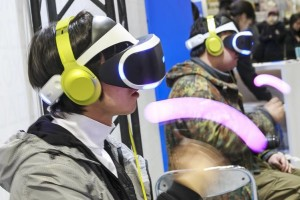 Visitors test PlayStation VR in Tokyo on March 26. Sony is planning a new version of its PlayStation 4, which could be unveiled before the planned October release of the PlayStation VR.