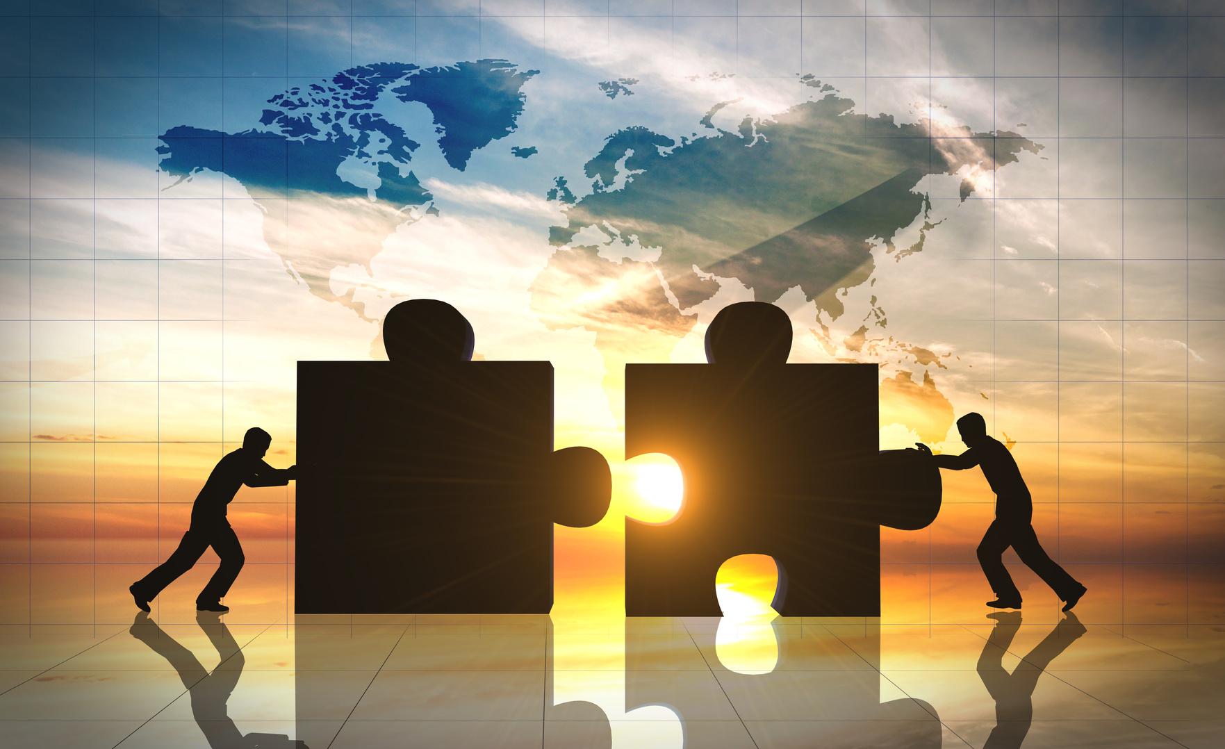 World Business teamwork puzzle pieces