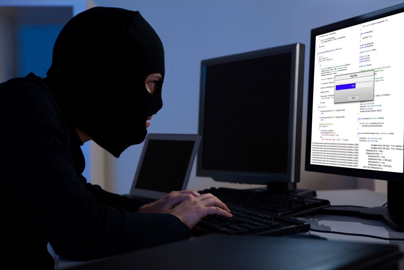 hacker-downloading-information-off-a-computer