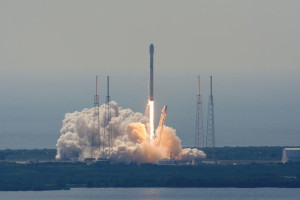 Vehicle Assembly Building roof at the Kennedy Space Center, a Falcon 9 rocket lifts off at 10:29 a.m. EDT (1429 GMT) with the Eutelsat 117 West B and ABS 2A communications satellites. Image courtesy- spaceflightnow.com