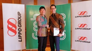 Anthony Tan, Group CEO and Co-Founder, Grab and John Riady, Director, Lippo Group shake hands after signing the strategic partnership agreement between Grab and Lippo Group on 21 March 2016. Image -dealstreetasia.com