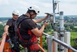 KPN technicians install a LoRa gateway onto a mobile transmission tower in the Netherlands, as part of the rollout of a new IoT-dedicated network. Courtesy-gizmag.com
