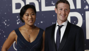 Mark Zuckerberg (R), and wife Priscilla Chan REUTERS/Stephen Lam
