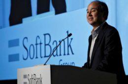 softbank slashes investments