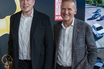 Volkswagen CEO Herbert Diess with Tesla CEO Elon Musk