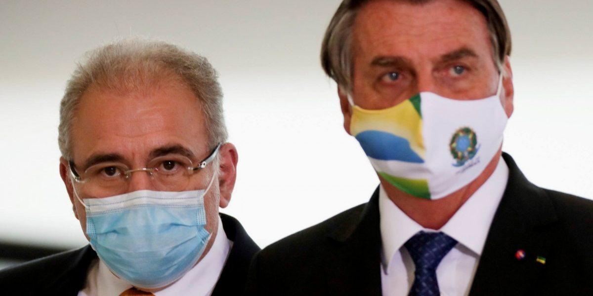 Brazil's health minister Marcelo Queiroga and Brazil's President Jair Bolsonaro