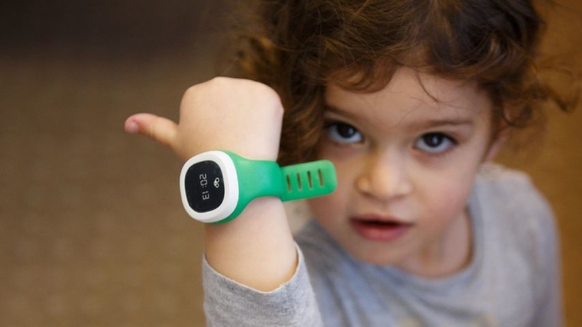 Child with kid's wearable wrist watch