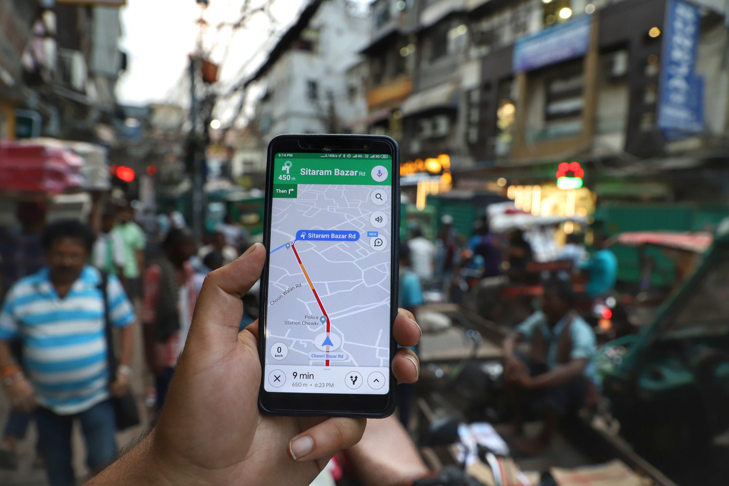 A user searches his destination via Google Maps in New Delhi India