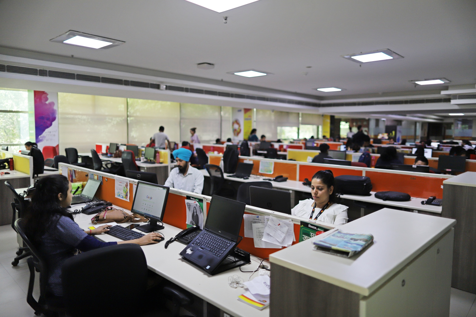 People working in Office of an IT company