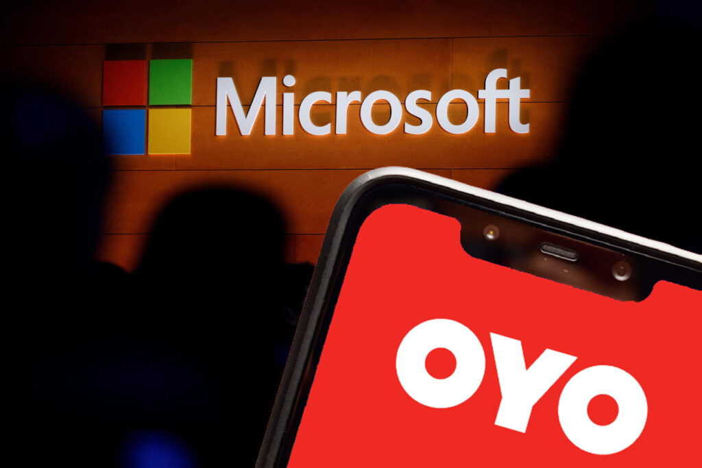 The Microsoft logo is illuminated on a wall during a Microsoft launch event to introduce the new Microsoft Surface laptop with OYO Rooms logo on Poco F1