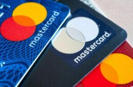 In this photo illustration there are three Mastercard Credit Cards. The branding and marketing logo of a financial company.