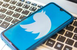 In this photo illustration a Twitter logo seen displayed on a smartphone.