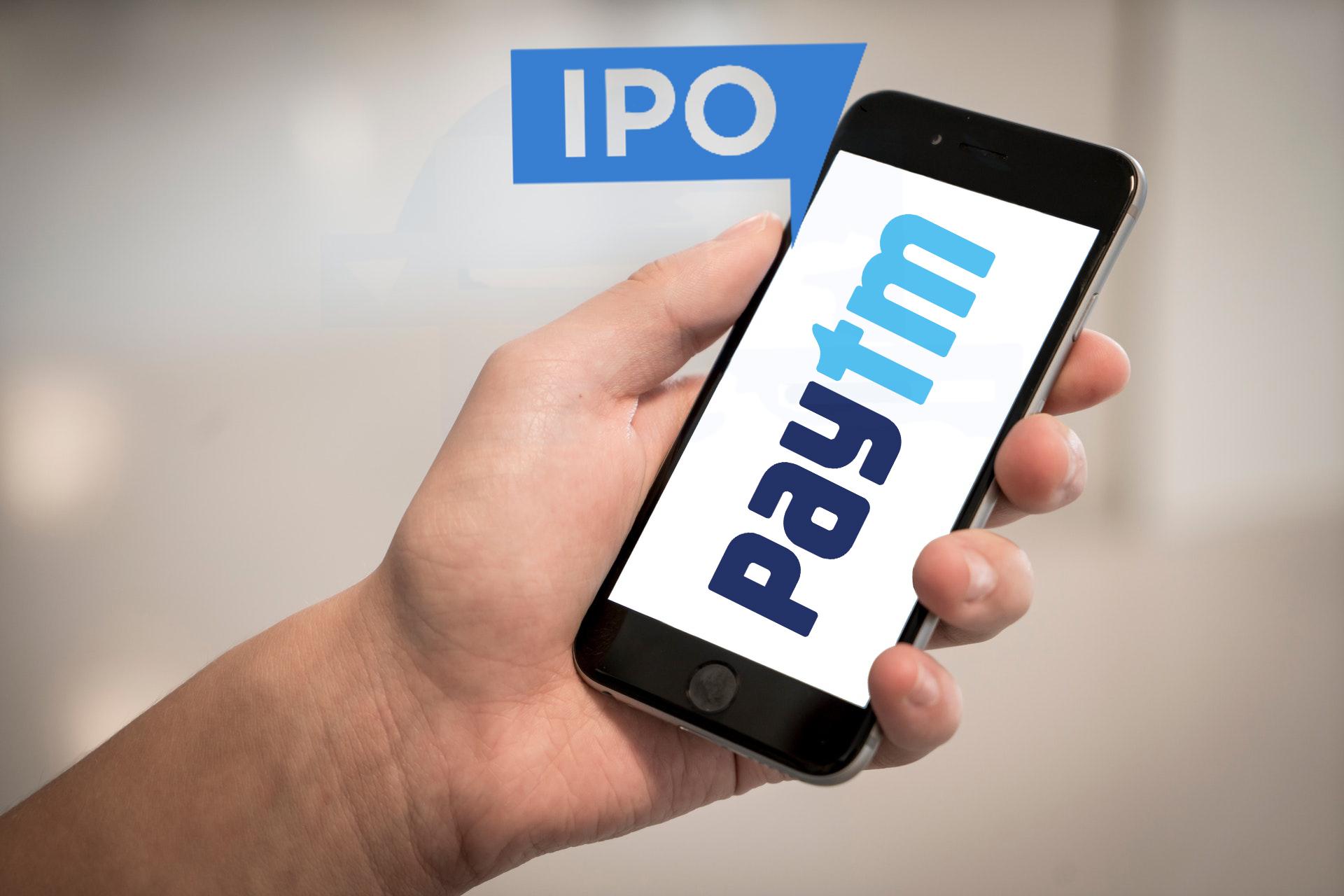 Person Holding Iphone Displaying Paytm Logo