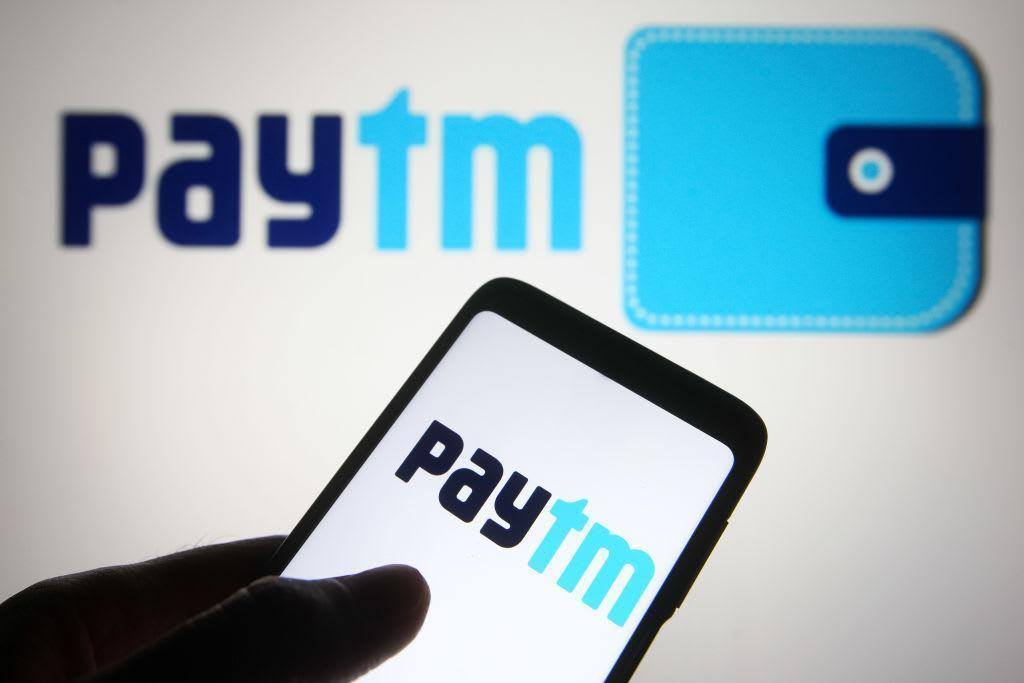 illustration Paytm logo seen on a smartphone and in the background