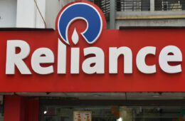 A Reliance logo can be seen in Kolkata, India