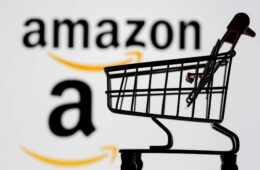 Amazon logo in background with Shopping Trolley in foreground