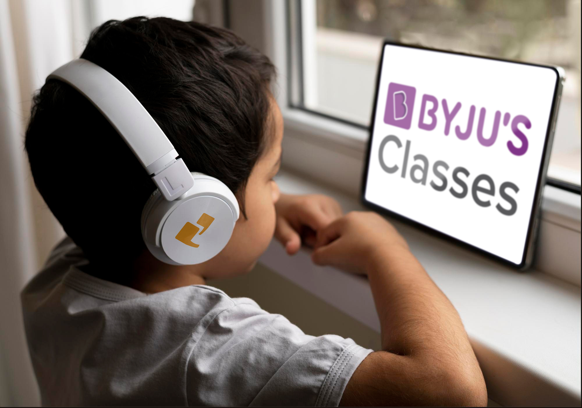 Boy with headphones exploring Byju's classes on his tablet
