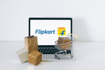 Brown Cardboard Box on Stainless Steel Shopping Cart Flipkart logo on Laptop
