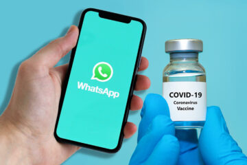 Person Holding iPhone with WhatsApp launching alongside COVID-19 Vaccine