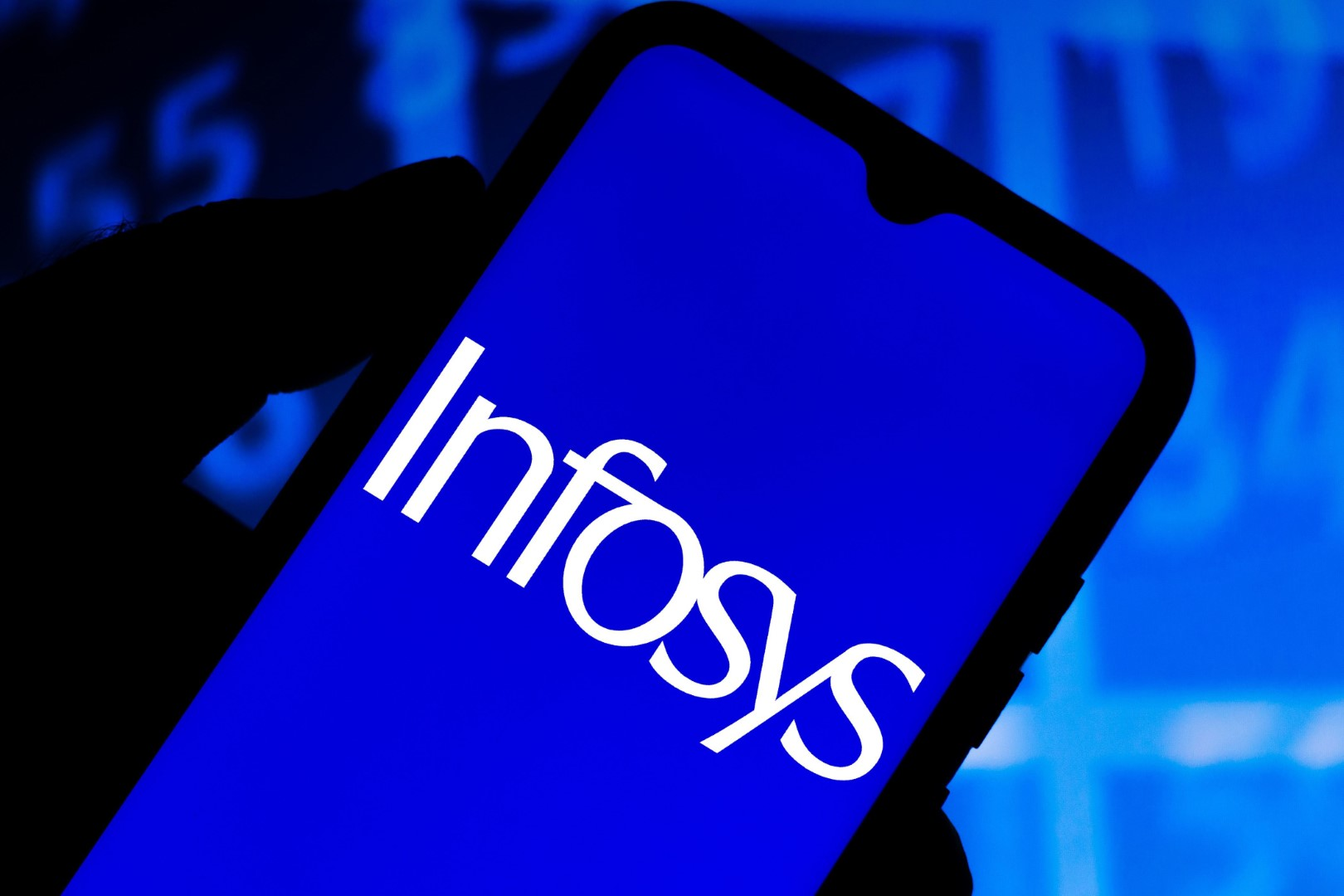 In this photo illustration the Infosys Limited logo seen displayed on a smartphone