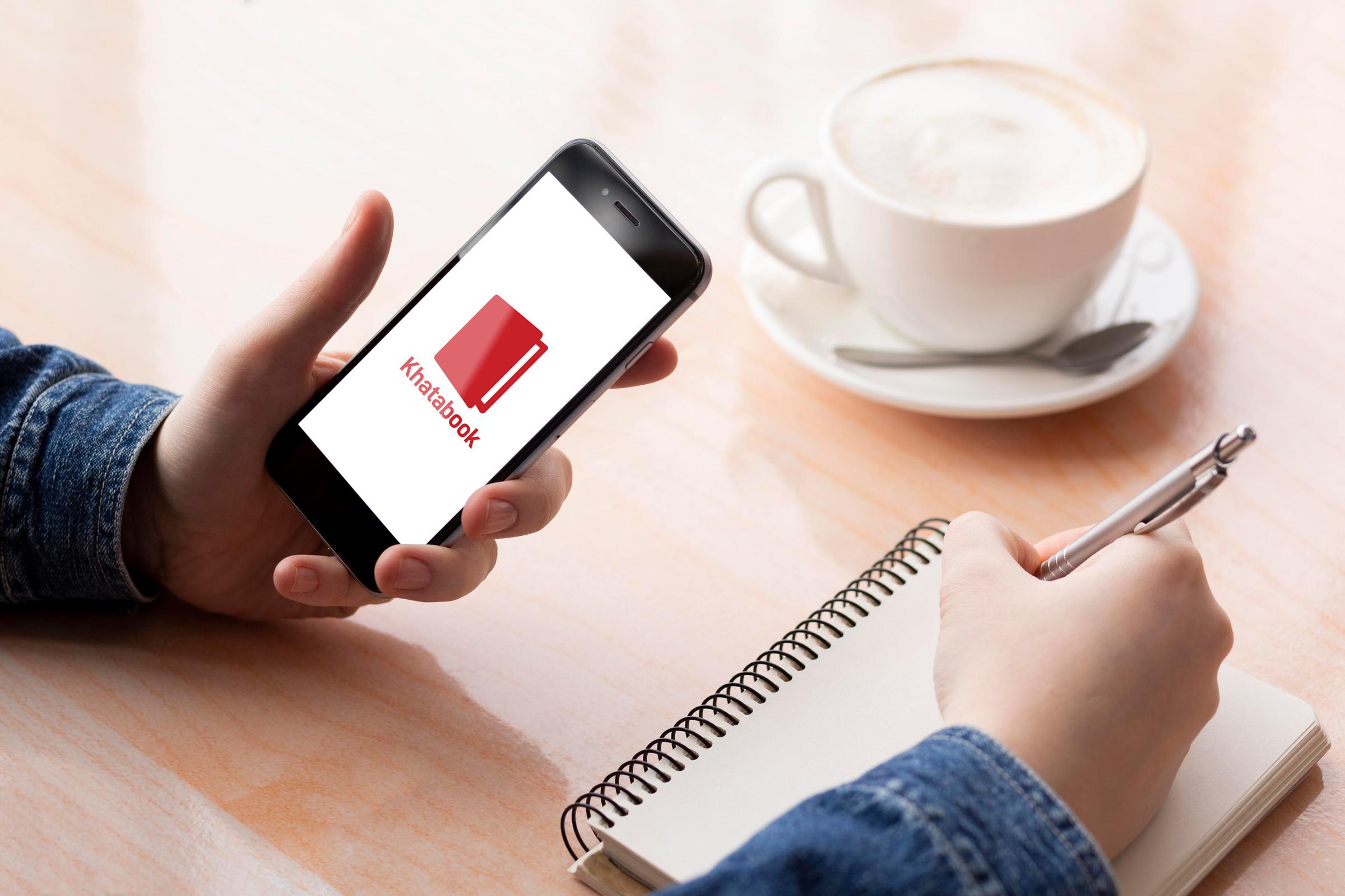 Man using Khatabook app on his smartphone