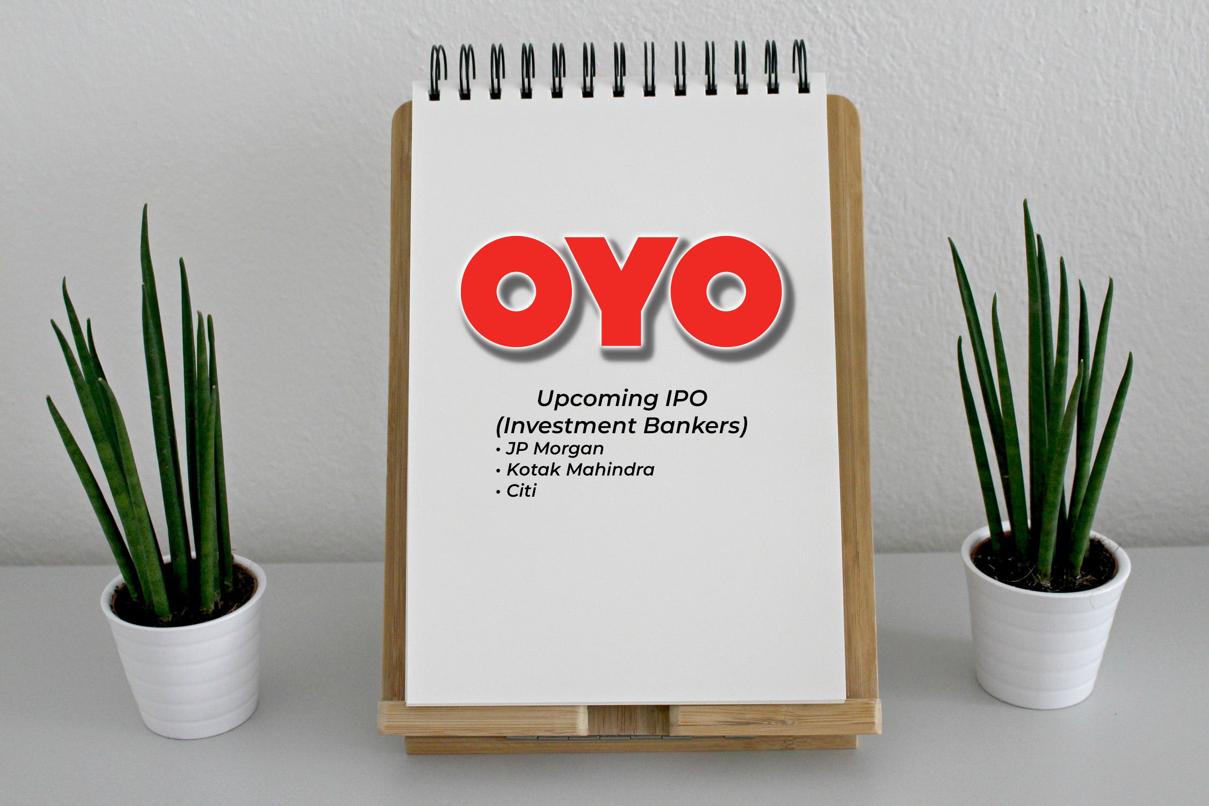 Oyo logo with investment banker names on a Drawing Book