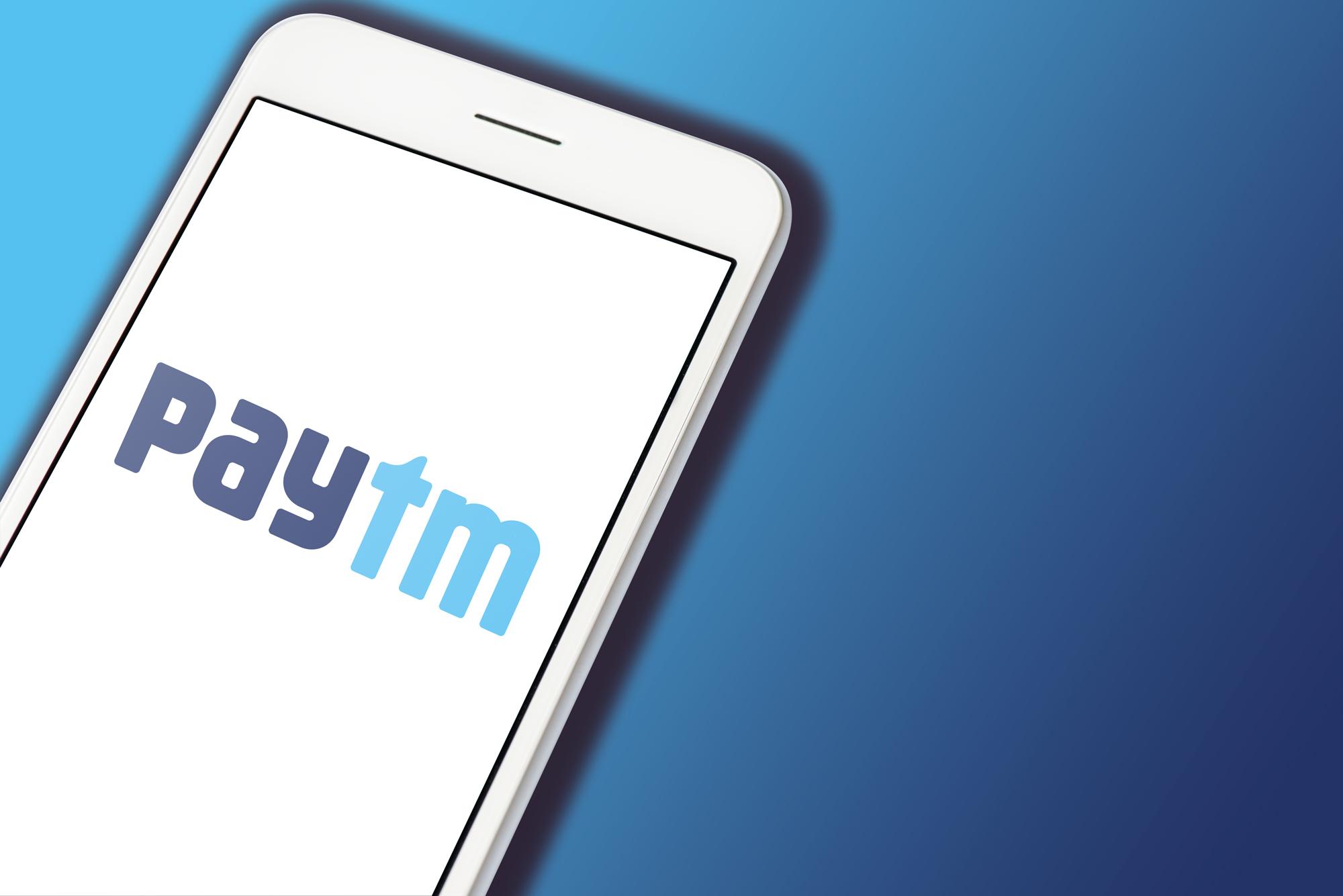 Paytm logo displayed on a White smartphone