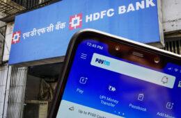 Smartphone with Paytm App near HDFC Bank Ltd. branch in Mumbai, India