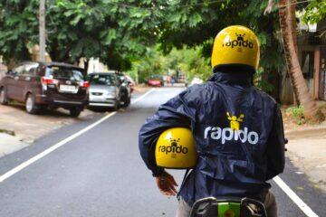 Rapido Captain riding bike wearing Rapido labeled helmet