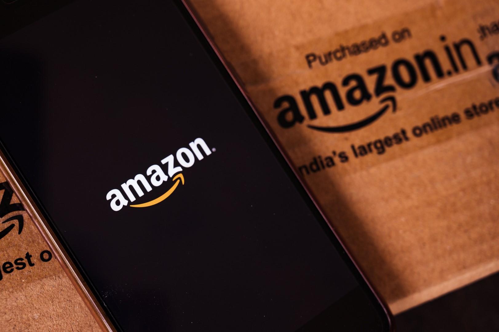 Amazon logo is seen displayed on a smartphone screen