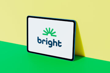 Bright Money logo displayed on colorful digital tablet