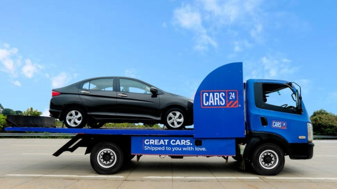 Car loaded on Cars24 delivery truck