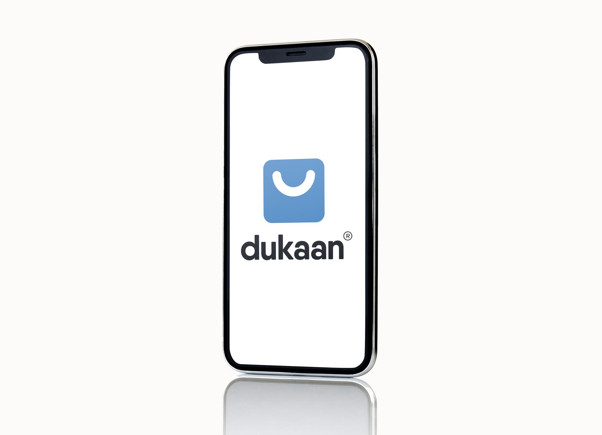 Dukaan logo displayed on iPhone 11