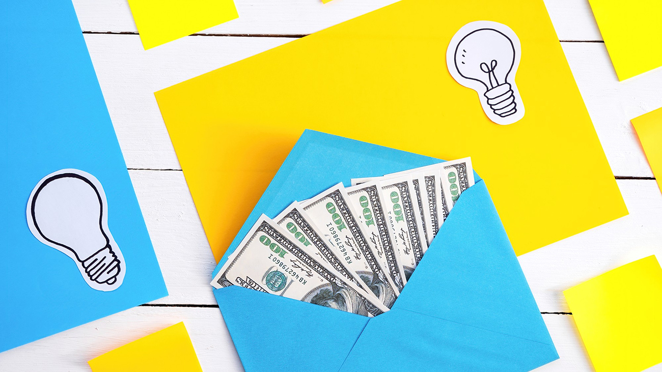 Blue envelope with money with yellow and blue papers, icons of lamp