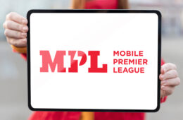 MPL logo displayed on a tablet holded by Redhead woman
