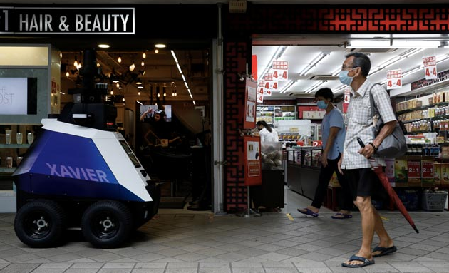 Singapore places robots in streets to patrol & detect bad social behavior