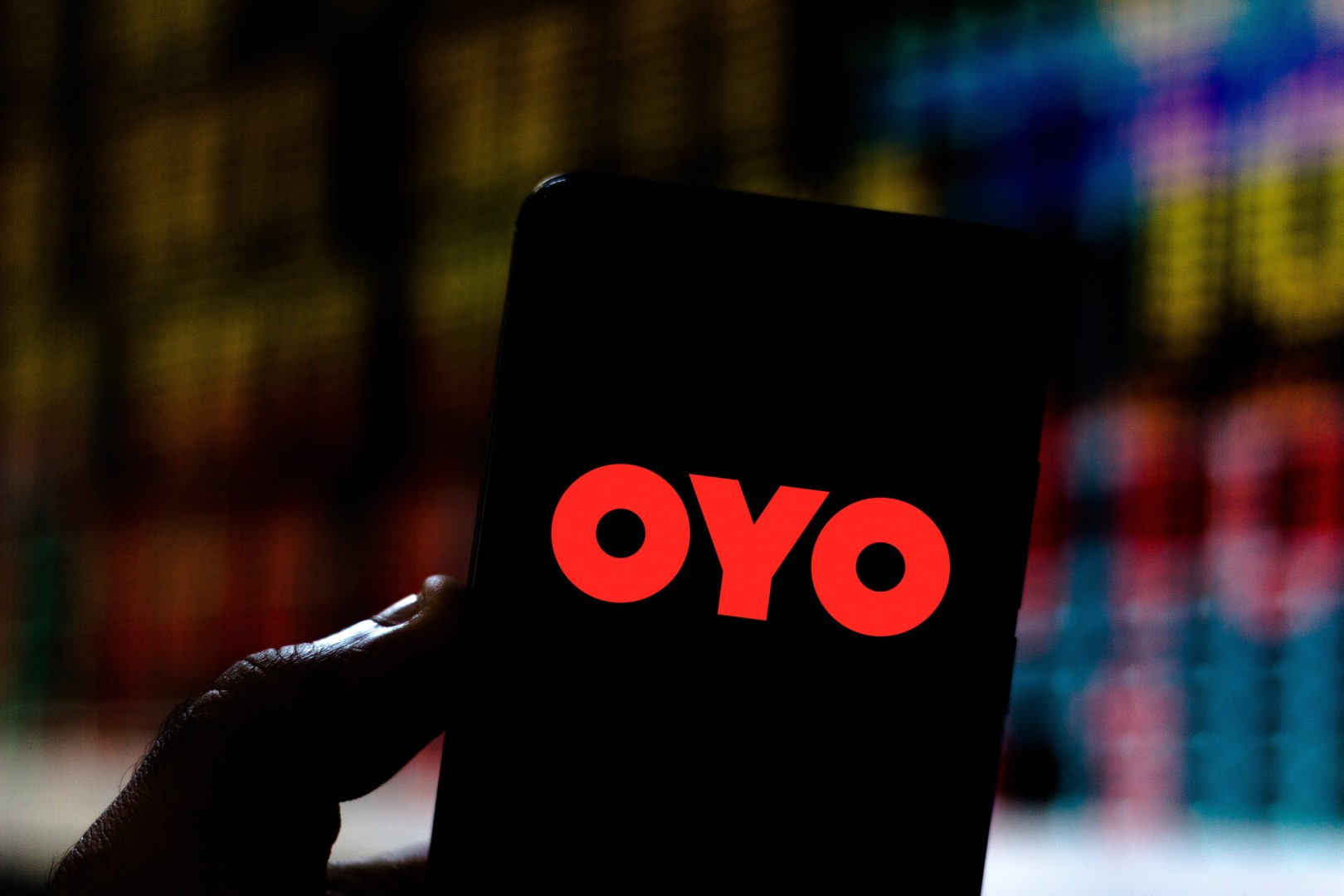 OYO Hotels & Homes logo seen displayed on a smartphone