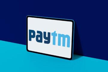 Paytm logo displayed on colorful digital tablet