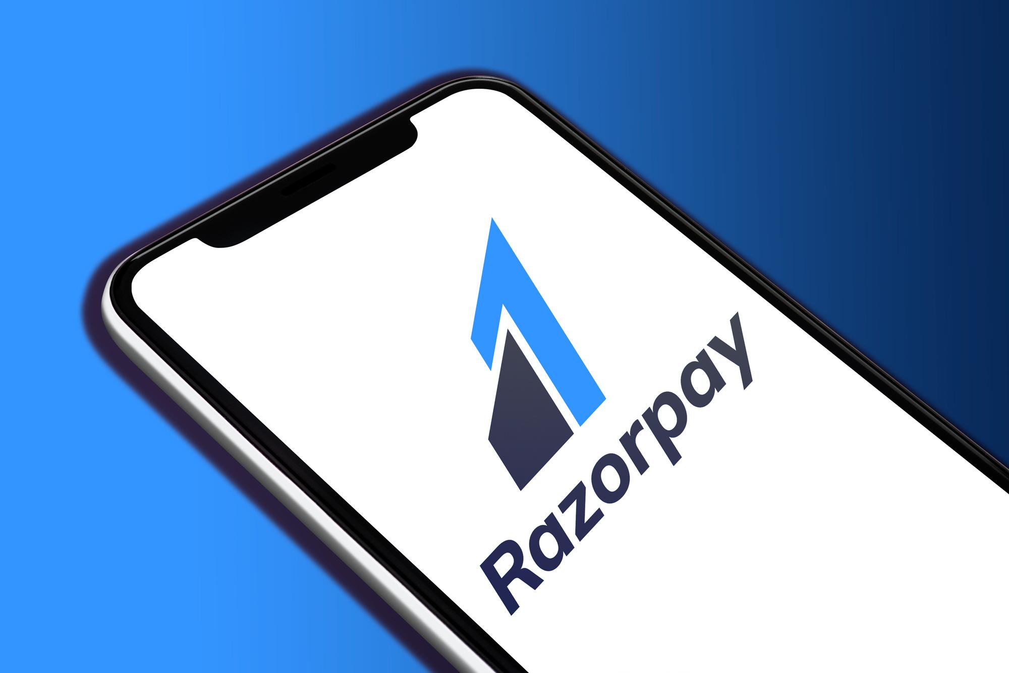 Razorpay logo displayed on a White smartphone