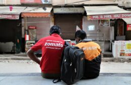 Swiggy and Zomato delivery boys take rest near the closed restaurants