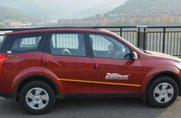 Zoomcar logo on a SUV