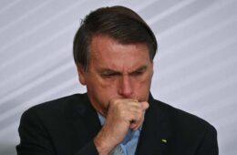 File photo showing President of Brazil Jair Bolsonaro coughing at Planalto Palace on December 9, 2020