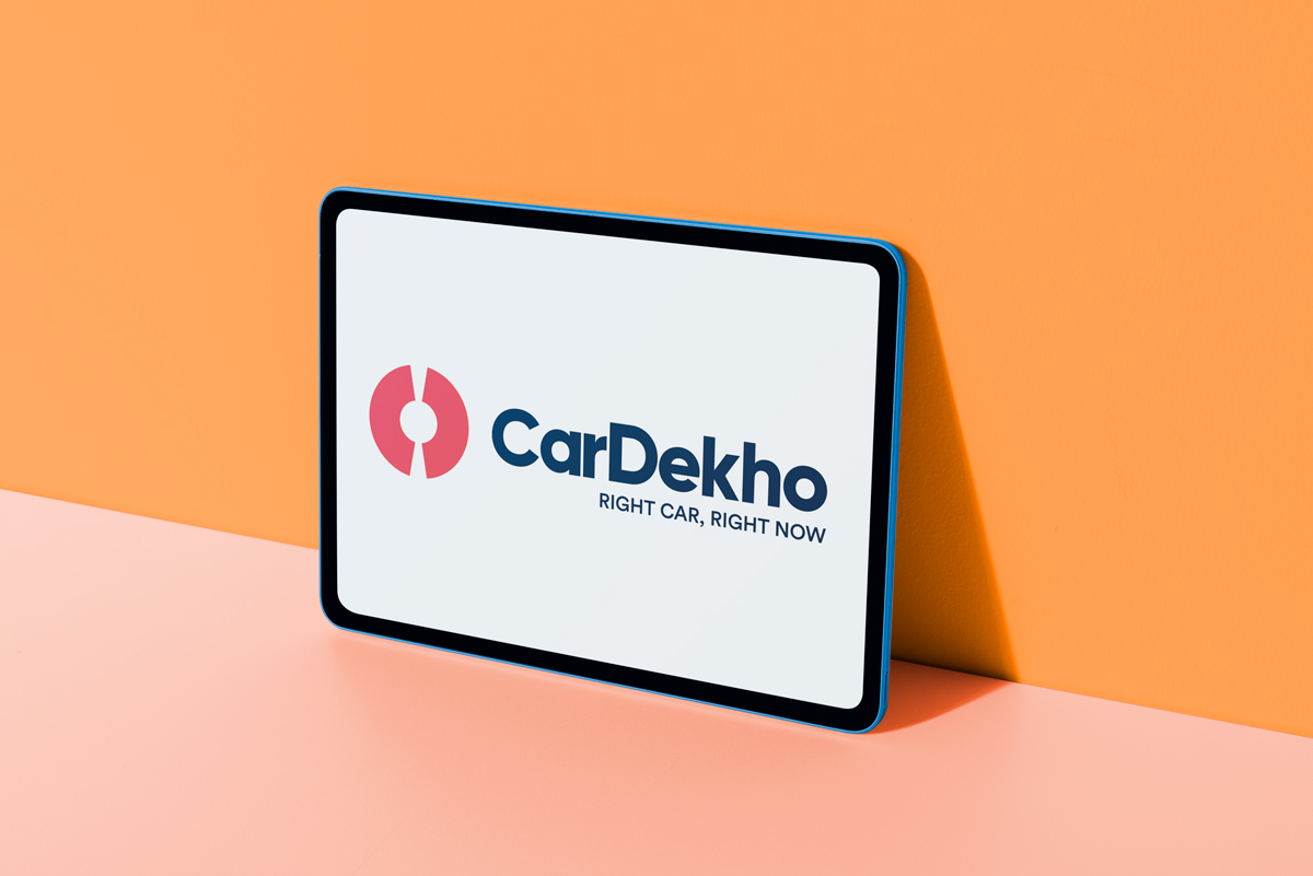 CarDekho logo displayed on Colorful digital tablet
