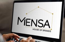 Mensa Brands logo on laptop screen
