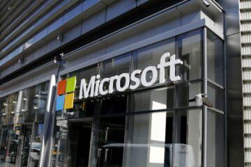 Microsoft logo is seen in a Microsoft store