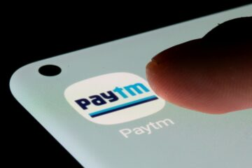 Paytm app is seen on a smartphone in this illustration