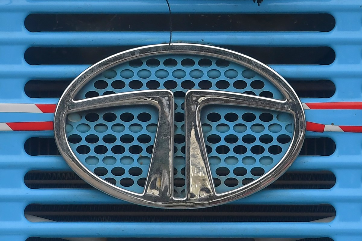 Tata Motors logo is seen on the engine grille of a truck