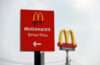 PakKret, Nonthaburi, Thailand - March 1, 2018: The red sign of McDonald drive thru at daylight and out focus dicut style of McDonald's logo. The McDonald's Corporation is the world's famous restaurant